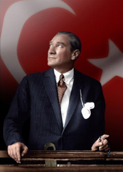 Mustafa_Kemal_Ataturk_looking_through_a_train_window_over_Turkish_flag